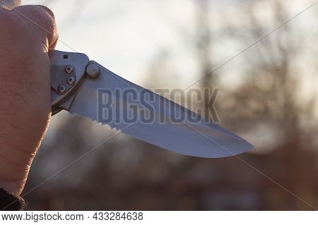 A Knife In The Man's Hand, A Symbol Of Terror And Violence.