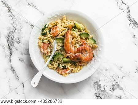 Delicious Mediterranean Lunch - Creamy Orzotto With Shrimp And Zucchini On A Marble Table, Top View