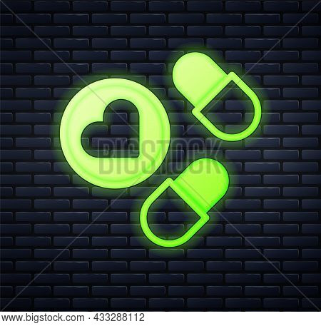 Glowing Neon Medicine Pill Or Tablet Icon Isolated On Brick Wall Background. Capsule Pill And Drug S
