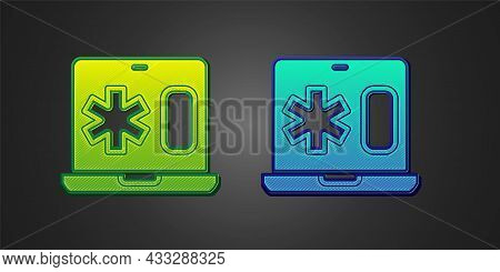 Green And Blue Medical Clinical Record On Laptop Icon Isolated On Black Background. Health Insurance