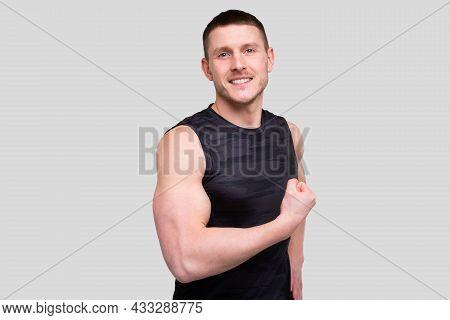 Man Showing Biceps. Sportsman Showing Muscles. Abs, Biceps Muscles. Sports Man Flexing Muscles.