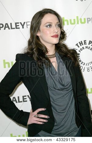 BEVERLY HILLS - MARCH 14: Kat Dennings arrives at the 2013 Paleyfest