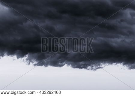 Dark Monochrome Heavy Storm Clouds Before A Thunderstorm Or Hurricane. Dramatic Clouds In Overcast W
