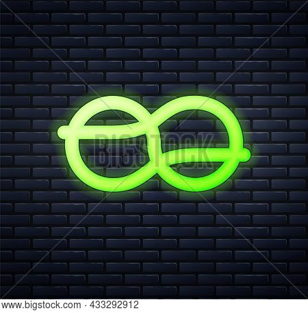 Glowing Neon Nautical Rope Knots Icon Isolated On Brick Wall Background. Rope Tied In A Knot. Vector
