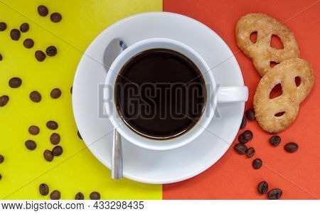 Black Coffee In A White Coffee Cup On A Bright Background. Top View, Flat Lay, Copy Space. Cafe And