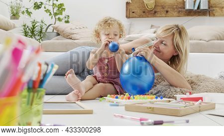 Smiling Mother With Blonde Curly Haired Daughter Child, Preschool Learning Activity At Home, Concept