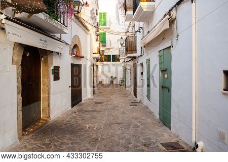 The Architecture Of The Island Of Ibiza. A Charming Empty White Street In The Old Town Of Eivissa