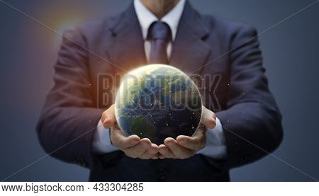 Businessman Hold Global World. Planet Earth In Hand Of Business Man Show Global Warming, Save Enviro