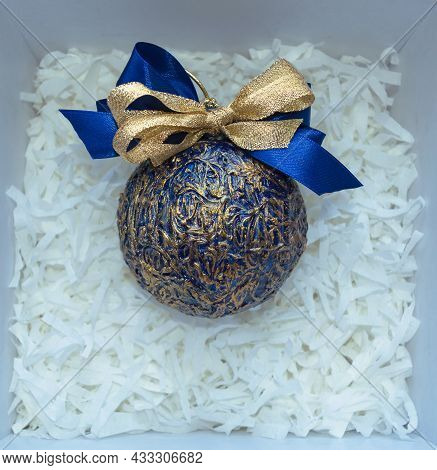 Handmade And Decorated With Gold And Dark Blue Bow Christmas Ball Inside Gift Box