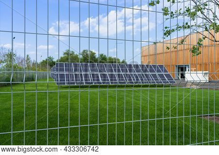 Solar Panels Plant For Small Eco-friendly Facility Over The Fence View