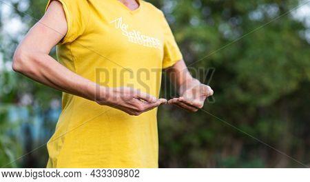 woman doing qi gong outdoors
