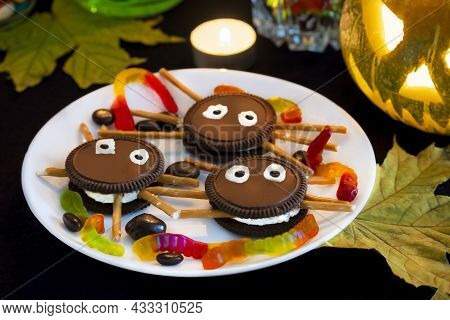Themed Halloween Dessert Decor In The Form Of Spiders Made Of Chocolate Cookies, Sweet Sticks And Wh
