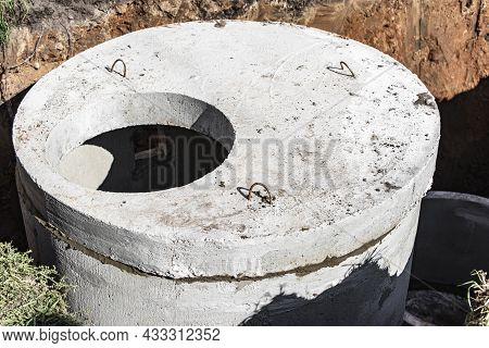 Installation Of Concrete Sewer Wells In The Ground At The Construction Site. The Use Of Reinforced C