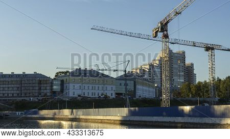 Panoramic View Of Construction Site In The Historical City Centre With A Couple Of Tall Yellow Crane