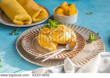 Sticky Rice And Mango Crepe Cake Roll Hong Kong , Thai Food Style In Summer. Plate Of Delicious Crep
