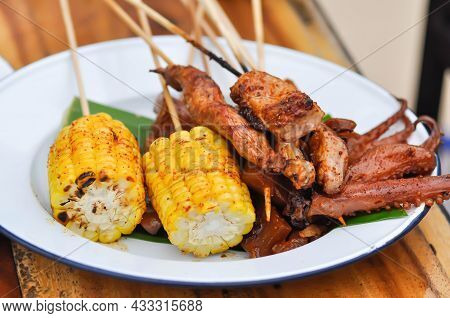 Grilled Squid, Grilled Pork And Grilled Corn And Grilled Chicken