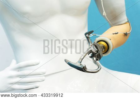 Metal Prosthetic Arm. Plastic Mannequin With Artificial Hand For Work. Cropped Frame. Close-up