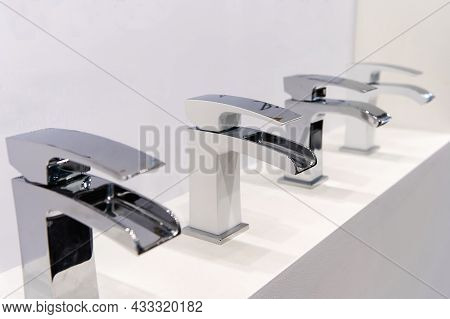 Chrome Bathroom Taps. Plumbing Trade In A Specialized Household Goods Store