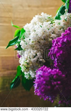 Bouquet Of White And Purple Lilacs With Water Drops On Golden Background
