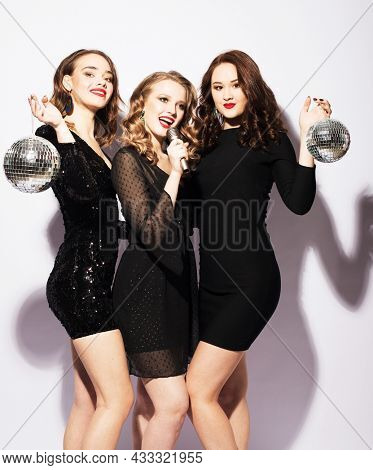 Party girls in black dress with disco balls