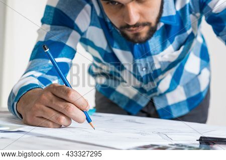 Man Drawing With Pencil On Construction Blueprint. Architect Workplace With Technical Drawing. Archi