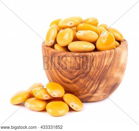 Pickled Yellow Lupine Beans In Olive Bowl, Isolated On White Background. Tournus, Preserved Lupinus.