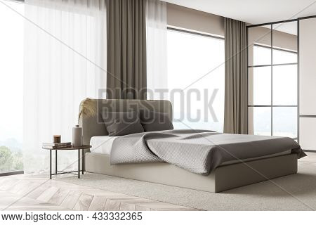 Corner Of The Modern Beige Bedroom Interior With Floor-to-ceiling Windows, A Black Frame Mirror, A N
