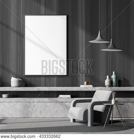 Empty White Canvas On The Wooden Wall Of The Dark Grey Seating Area With An Armchair, Two Pendant La