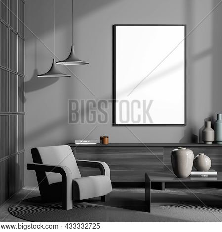 Dark Grey Seating Area With A Single Armchair, Minimalist Details, A Sideboard, Square Wall And Empt