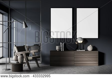 Two Canvases On The Dark Blue Wall Of The Living Room Interior Design With Concrete Flooring, A Side