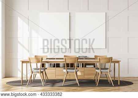 Two Empty Canvases On The White Living Room Wall With Panels. Interior With A Table, Chairs, An Oval