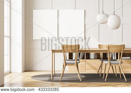 Two Canvases On The White Wall In An Interior With A Table, Chairs, An Oval Rug On The Parquet, Two