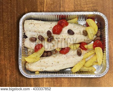 Sea Bass Fillet With Baked Potatoes And Olives