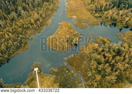 Autumn Lake Surrounded By Forest Izvara Park And Ecological Trail, Volosovsky District, Leningrad Re