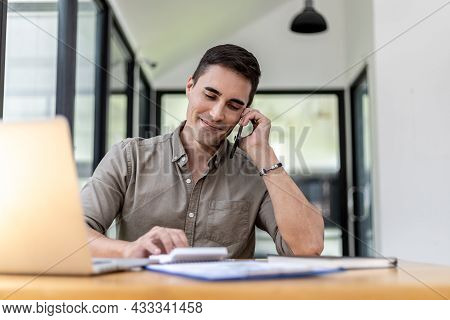 Man Talking On The Phone In The Office, He Is A Businessman Executive Of A Startup Company Founded W