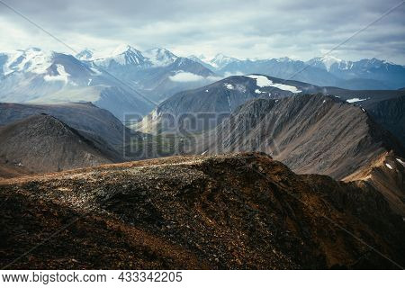 Awesome Highland Landscape With Sharp Rocky Ridge In Background Of Mountain Valley And Snowy Mountai