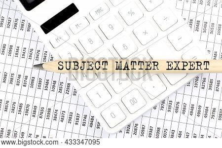 Text Subject, Matter, Expert On Wooden Pencil On The Calculator With Chart