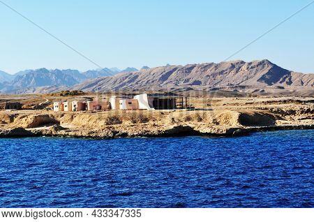 Panoramic View From The Sea To The Coastline. Red Sea, Coast With Small White Houses Against The Bac
