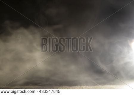 Blurry Motion Of Smoke. Abstract Design Of White Cloud On A Dark Background. Blurry Motion Of Smoke.