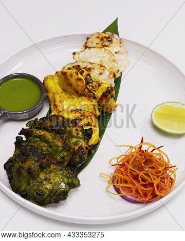 Multi Flavored Tandoori Chicken Tikka, Cream, Saffron And Spinach Based Marinated Chicken Cubes Cook
