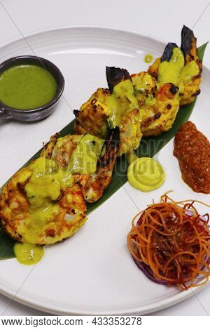 Indian Clay Oven Roasted Saffron And Yoghurt Marinated Shrimps Or Prawns, Known As Tandoori Prawns O