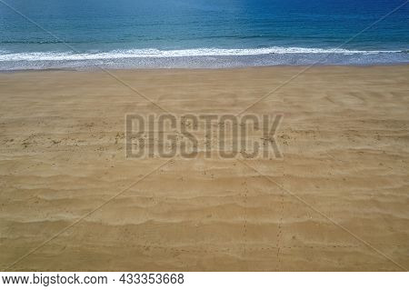 Close Up Of The Waves In The Sand And Prints Of Natural Sea Creatures With The Lacy Texture Of The O