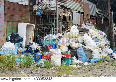Pile Of Garbage To Sort, Recycle And Reuse. One Of The Ways To Reduce Waste. Photo Taken In Benguet,
