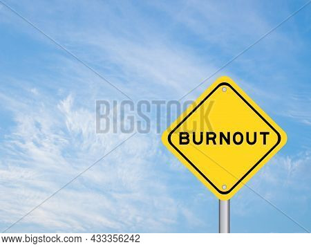 Yellow Transportation Sign With Word Burnout On Blue Sky Background