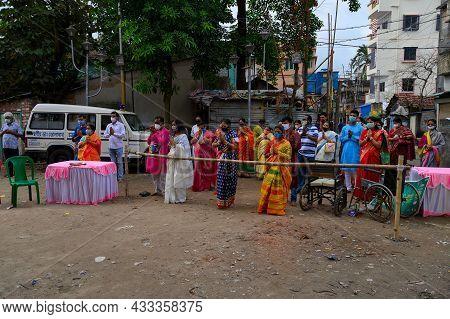 Howrah, West Bengal, India - 25th October 2020 : Masked Hindu Devotees Uttering Sanskrit Shlokas For