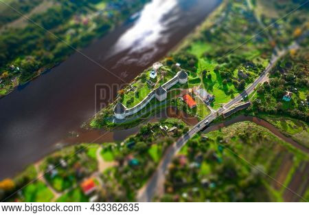 Aerial view of the old Russian fortress in the village of Staraya Ladoga in Russia with tilt shift effect applied