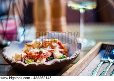 Caesar salad with crispy bread and bacon