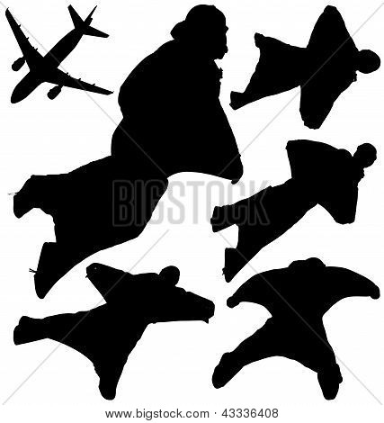 Wingsuit skydivers silhouettes