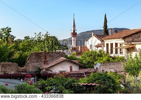 Sirince, Turkey - June 1, 2021: It Is A Minaret That Towers Over The Rooftops Of The Village Houses