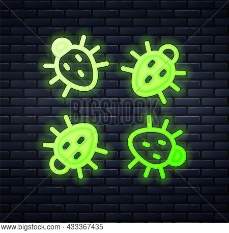 Glowing Neon Colorado Beetle Icon Isolated On Brick Wall Background. Vector